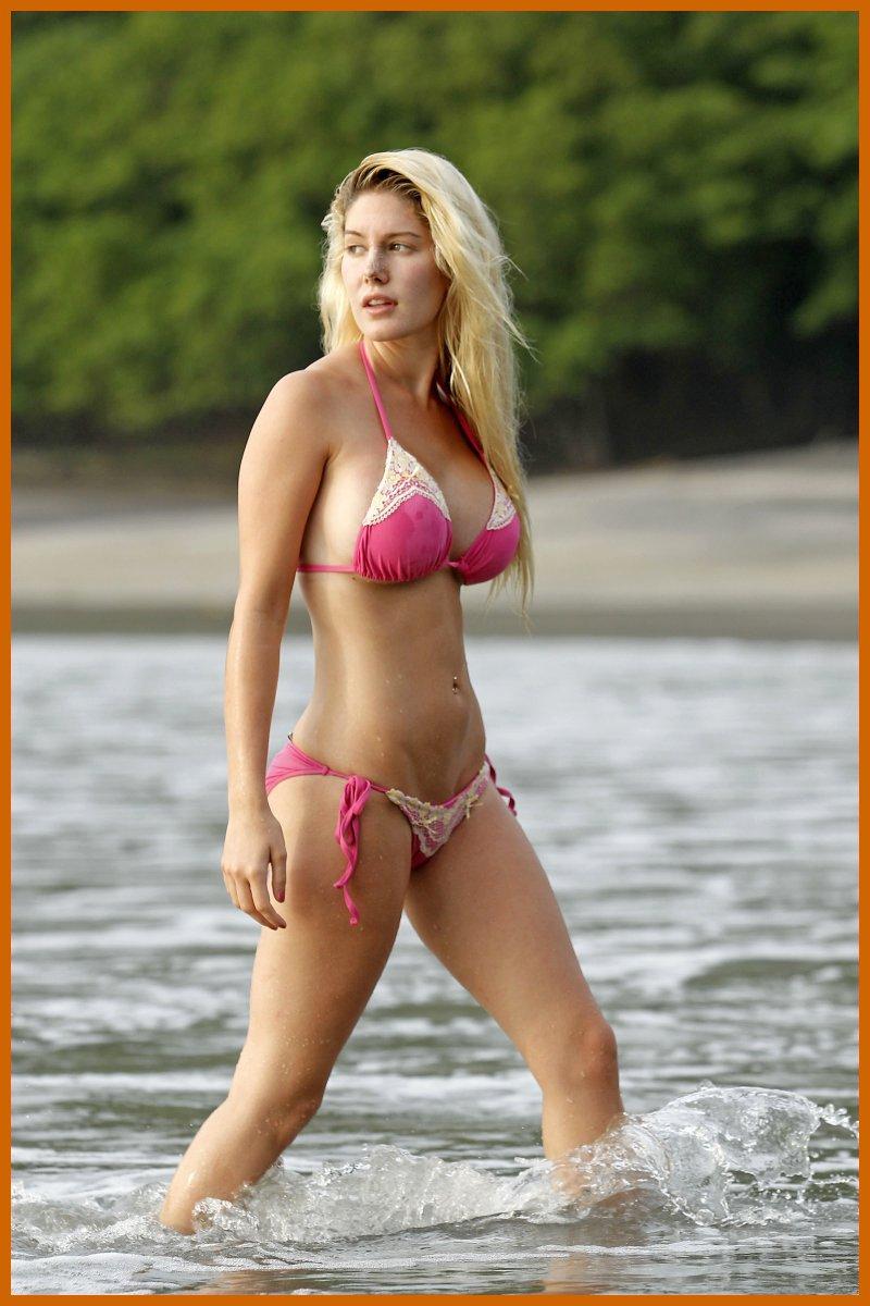 Busty blonde in bikini Alexis Ford sucks and fucks a hard cock.